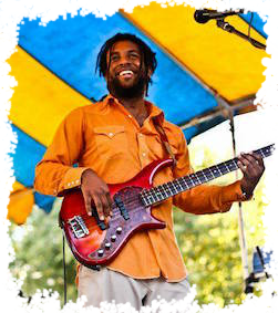 Orange Shirt playing bass with a smile