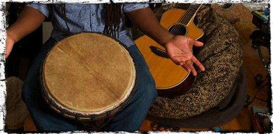 hand drum acoustic and shrugged shoulders